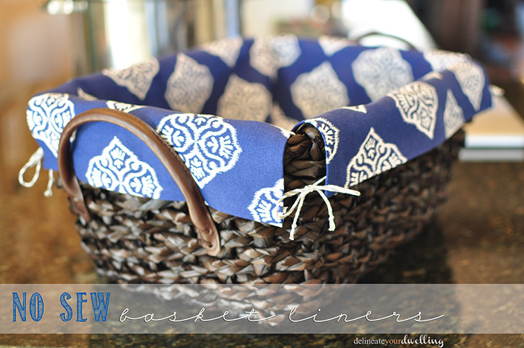 Blue and white fabric lining a wicker basket.