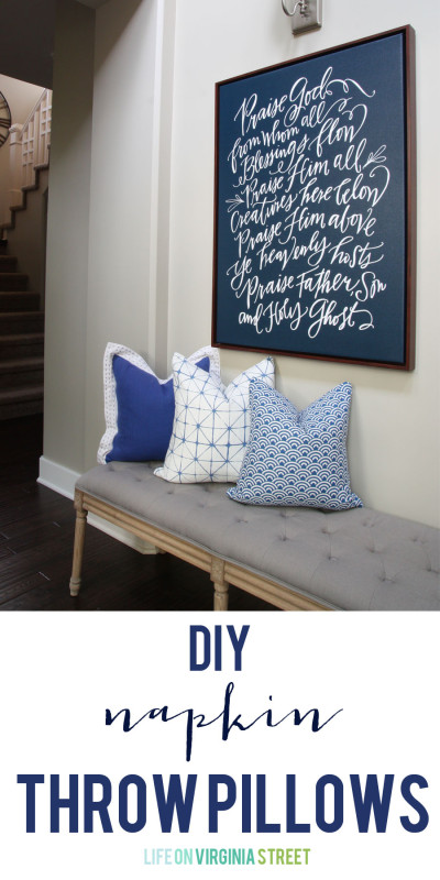 Blue and white pillows on a grey bench.
