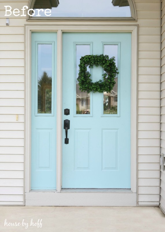 Light blue door and off white house.
