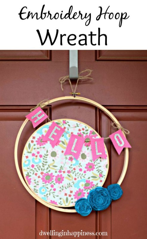Hoop wreath with floral fabric hanging on a door.
