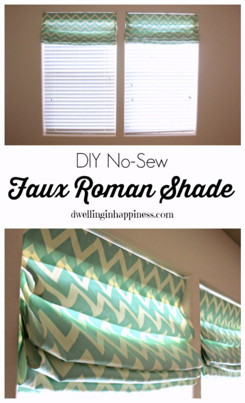 No sew green and white roman shades on window.