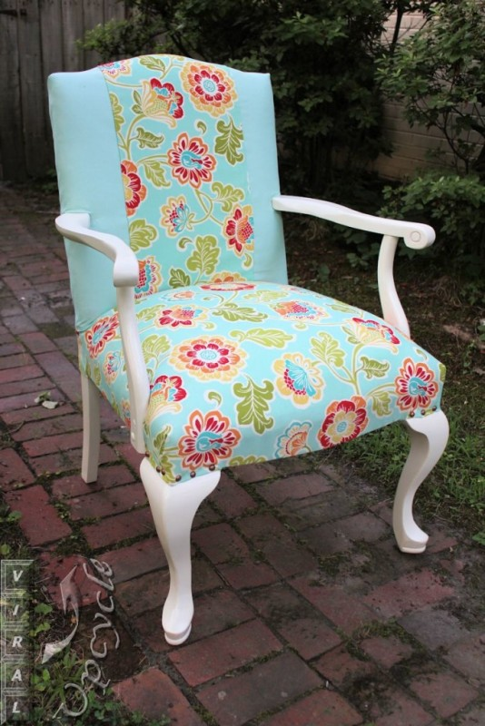 White chair reupholstered with blue floral.