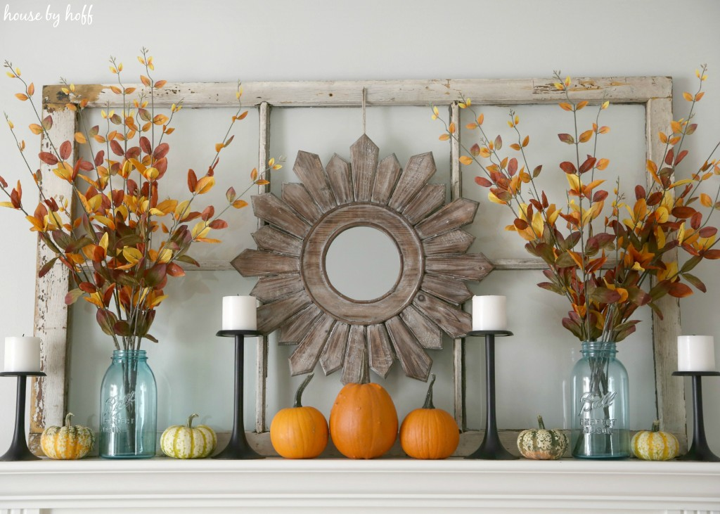 Wooden mirror hanging above mantel.