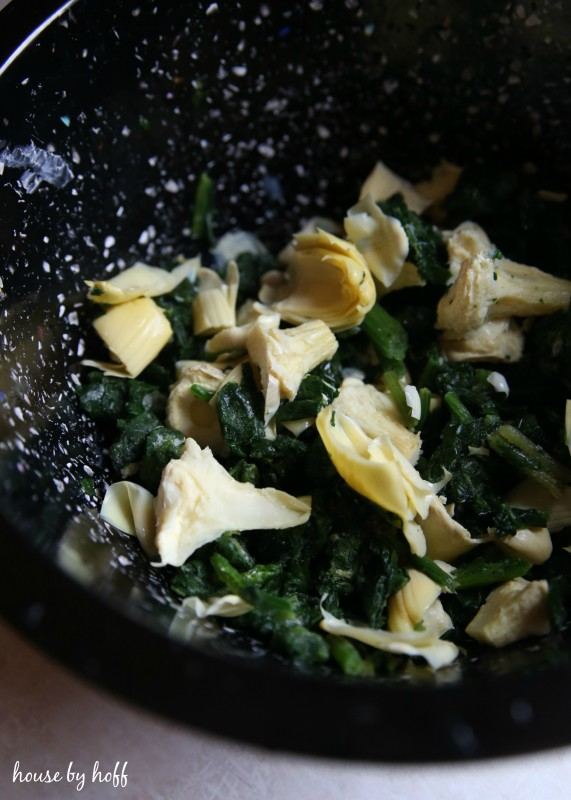 Artichoke and spinach in a bowl.