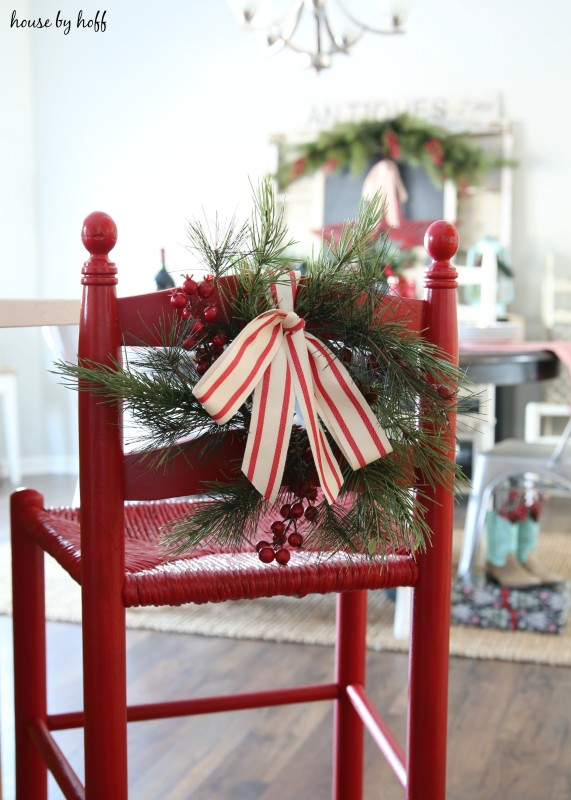 A striped red and white bow tied to the stool.