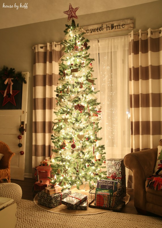 Christmas Home Tour with a large Christmas tree in front of a window.