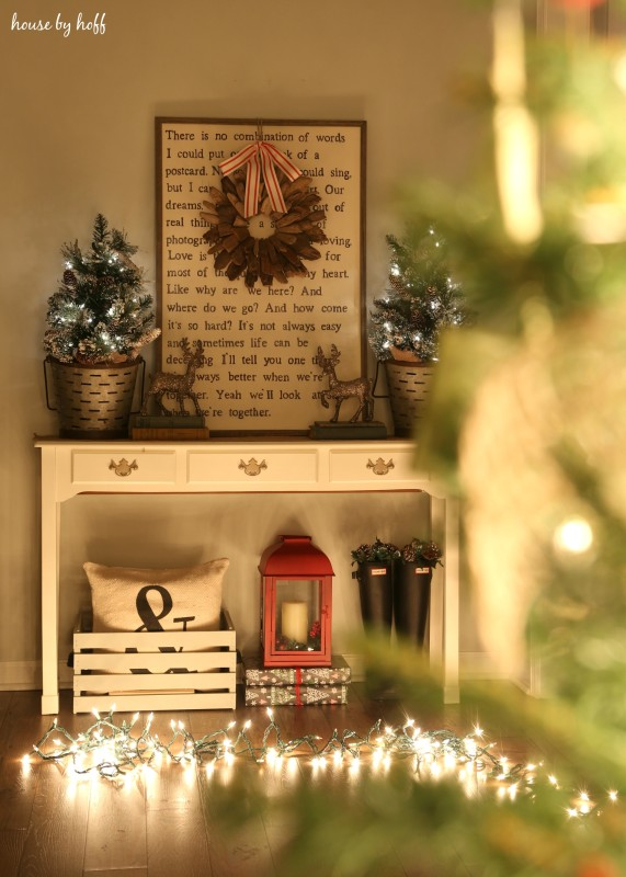 A console table in the hallway decorated for Christmas.