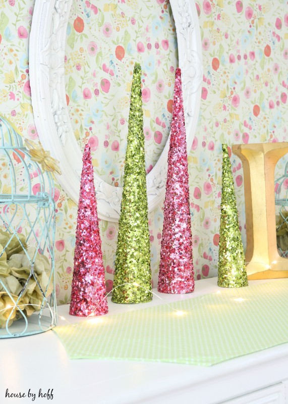 Pink and green sparkly trees on the dresser.