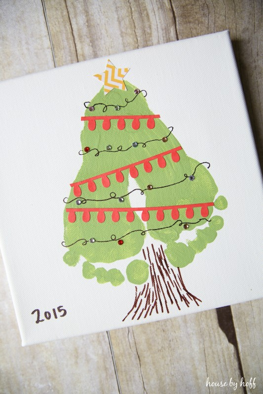The canvas footprints turned into a Christmas tree and decorated.