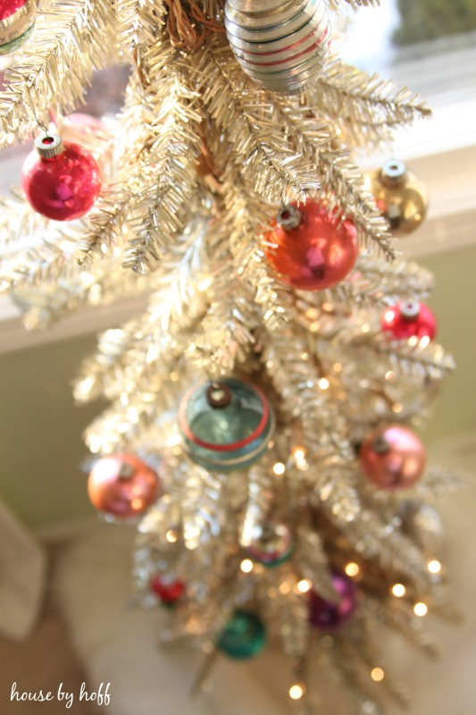 Red, green and gold ornaments on the tree.