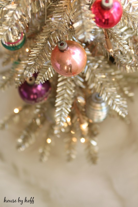 Pink vintage ornament on the Christmas tree.