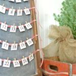 chalkboard-advent-calendar-next-to-mini-christmas-tree-closeup-681x1024