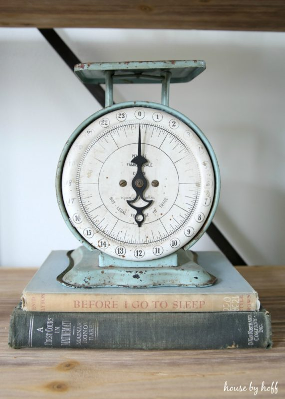 Vintage scale sitting on vintage books.