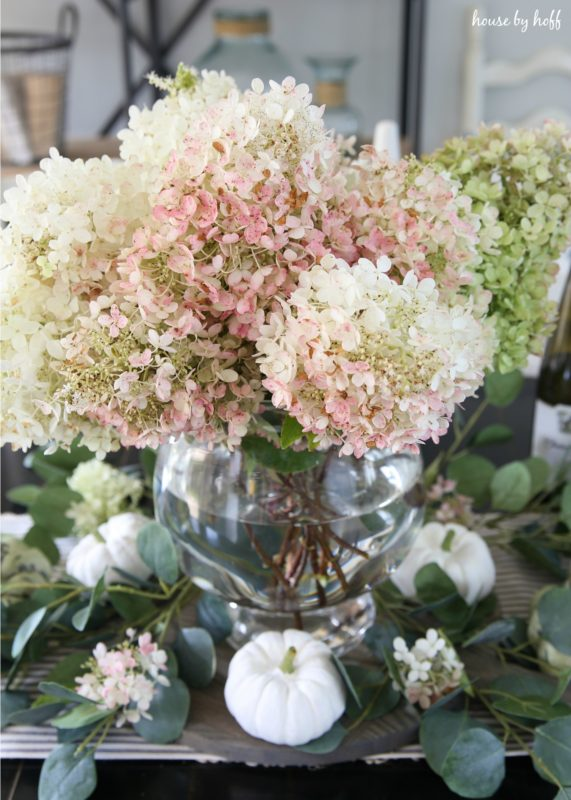 Pink hydrangeas with green hydrangeas in vase.