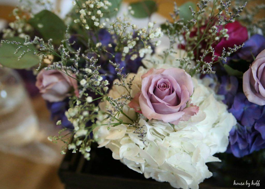 Floral arrangements on table.