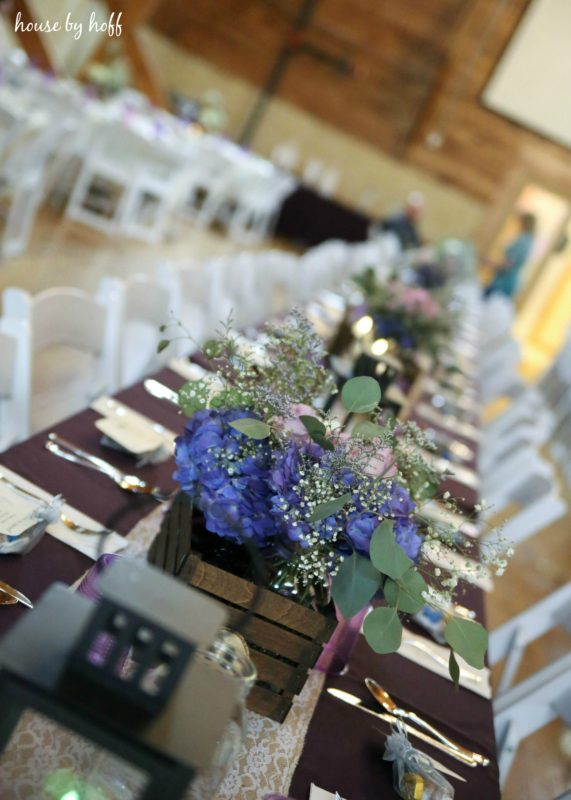Decorated tables with purple flowers.