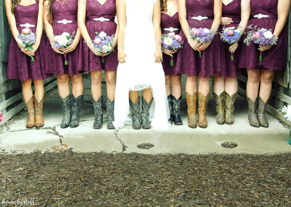 Cowboy boots with bridesmaid dresses and bride.