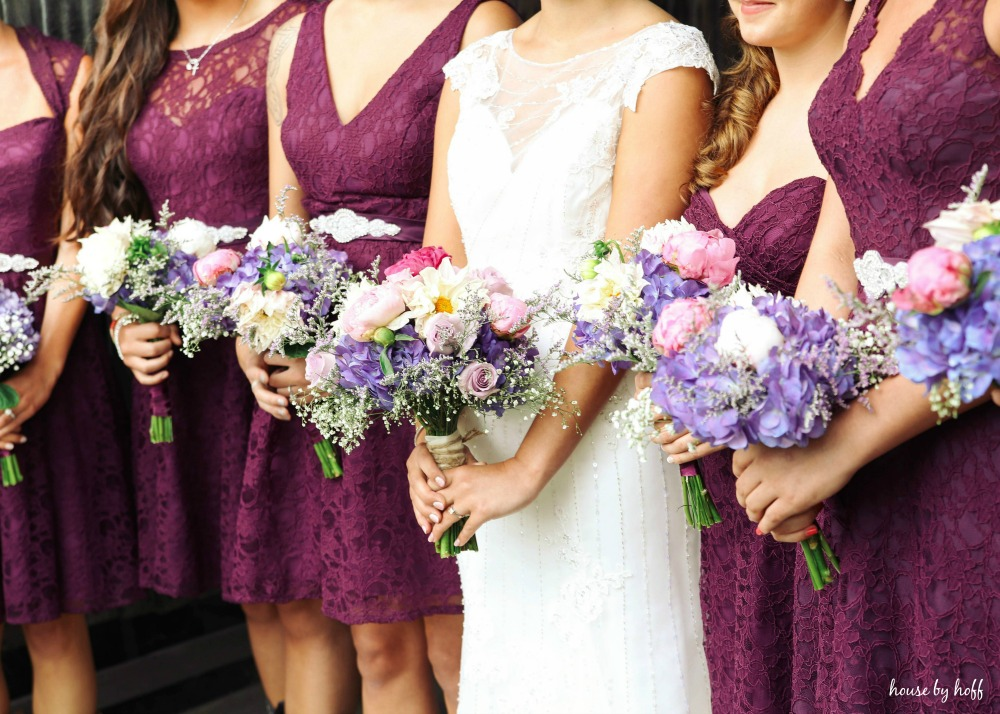 The bouquets with purple, white, and pink flowers.