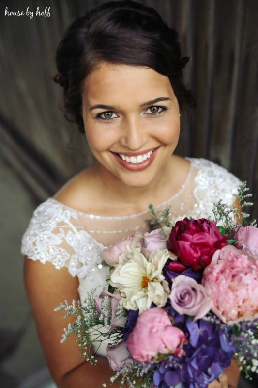 The bride with her bouquet smiling.