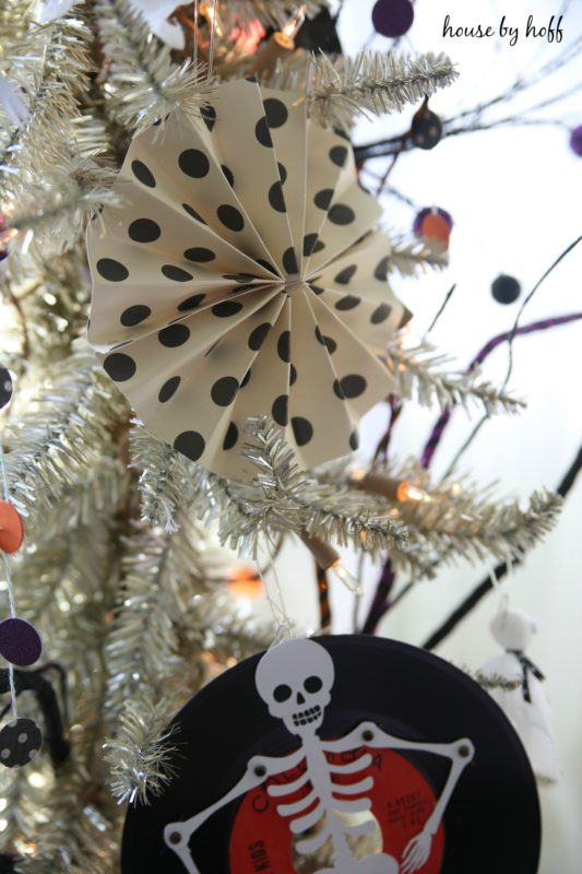 Black and white polka dot decorations on the white tree.