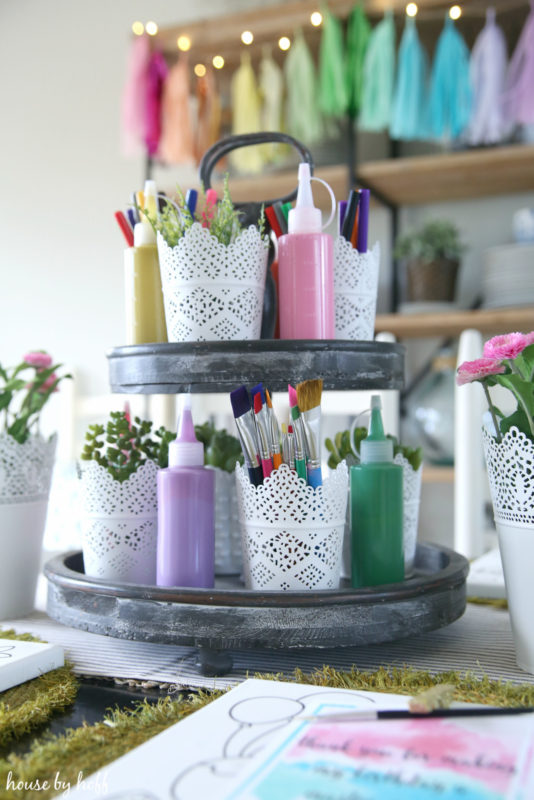 Paint brushes in a white containers.
