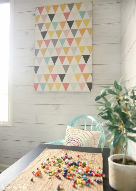 Geometric painting on shiplap wall.