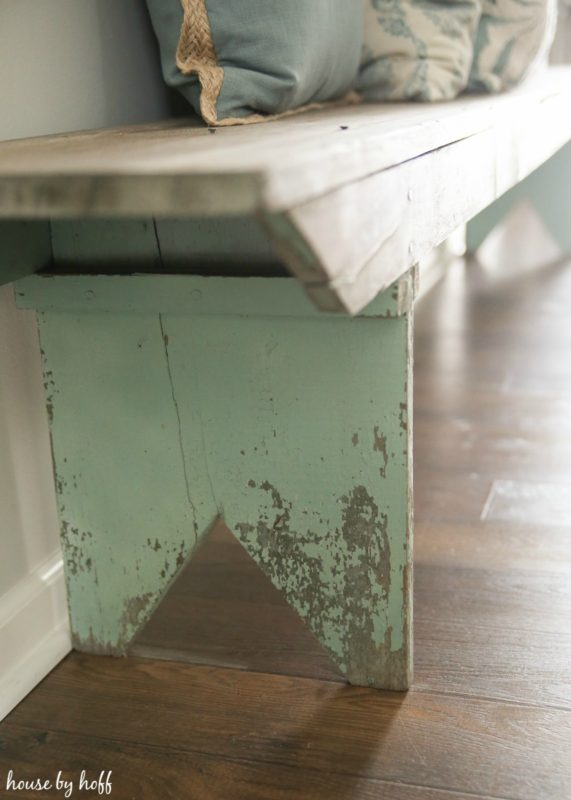 Rustic old bench on wooden floor.