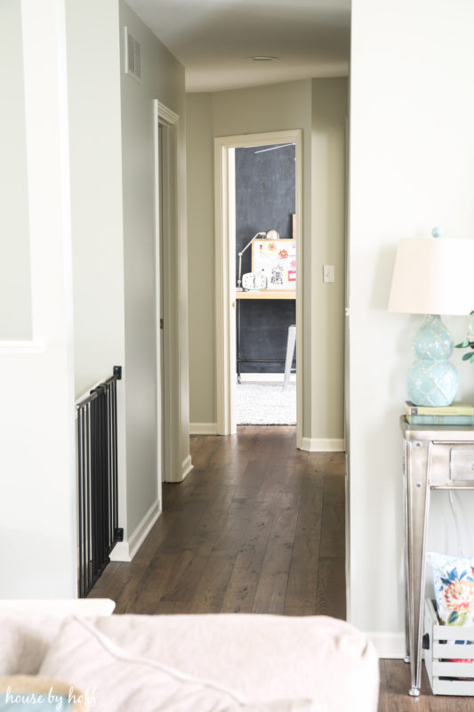 Laminate flooring in the hallway leading to the bedroom.