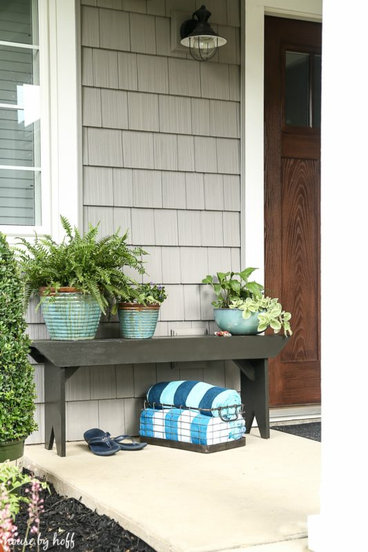 The finished bench outside by the front door.