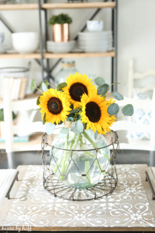 Sunflowers in a clear glass vase on the DIY serving tray.