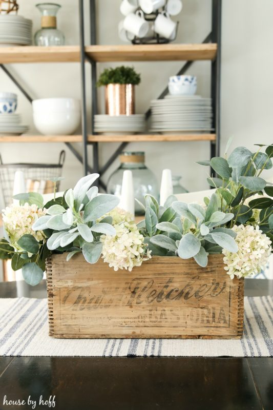 Adding the white hydrangeas to the the wooden crate.