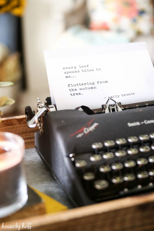 Typewriter with poem typed out on white paper.