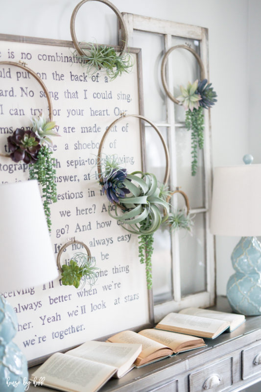The succulent wreaths on the wall in the hallway.