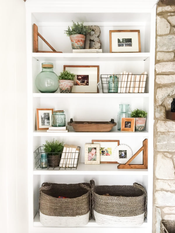 Large baskets on bottom shelf and wire baskets, and plants.
