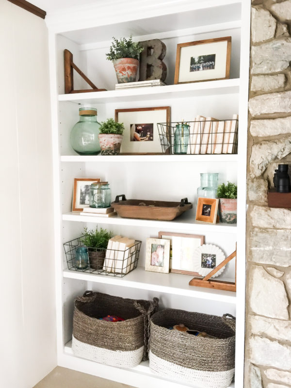 White open shelving with vases and plants on it.