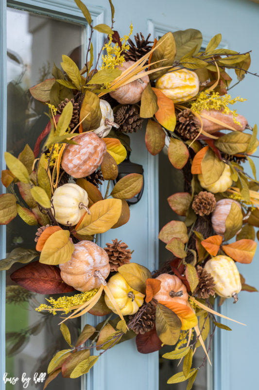 Yellow, orange, green and brown wreath on door.