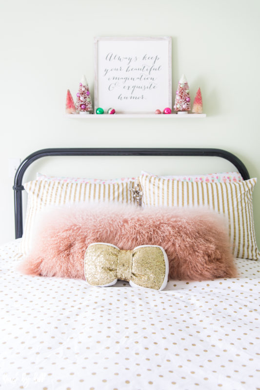 Pink Llama Fur Pillow Gold Sequined Pillow on Polka Dot Bedding.