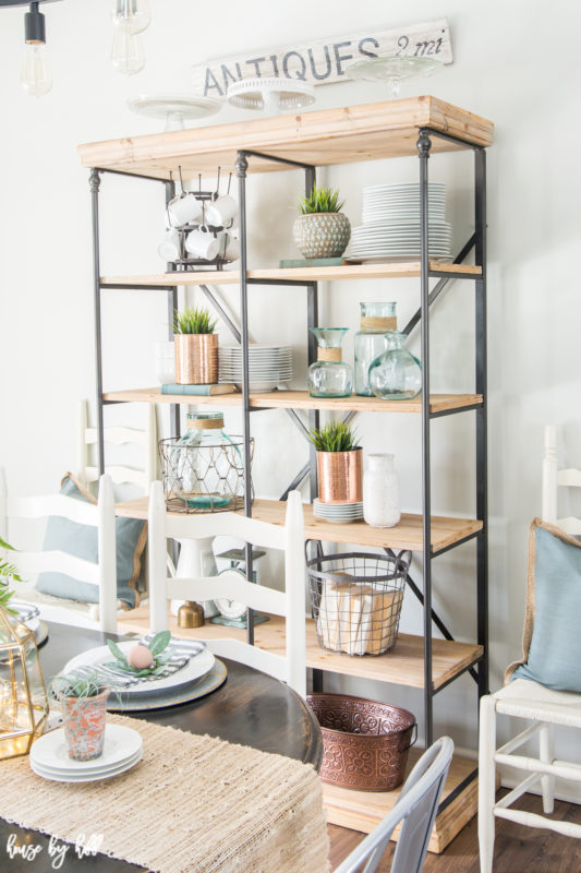 The open shelving with plates, wire baskets and copper vases.