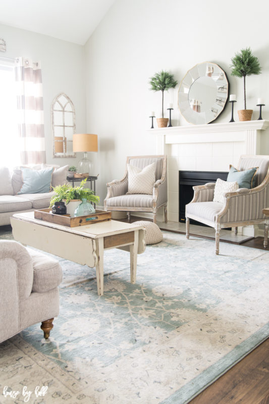 Soft blue toned persian rug in the living room.