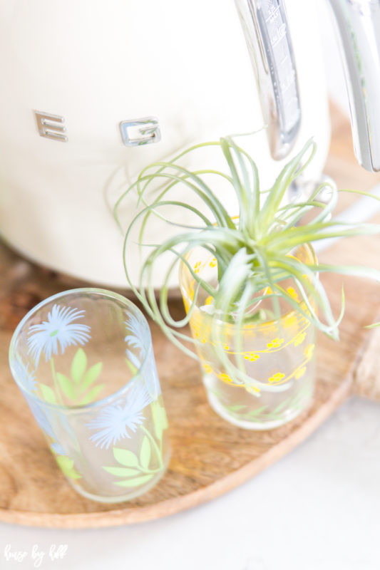 Clear vintage glasses with a floral pattern.