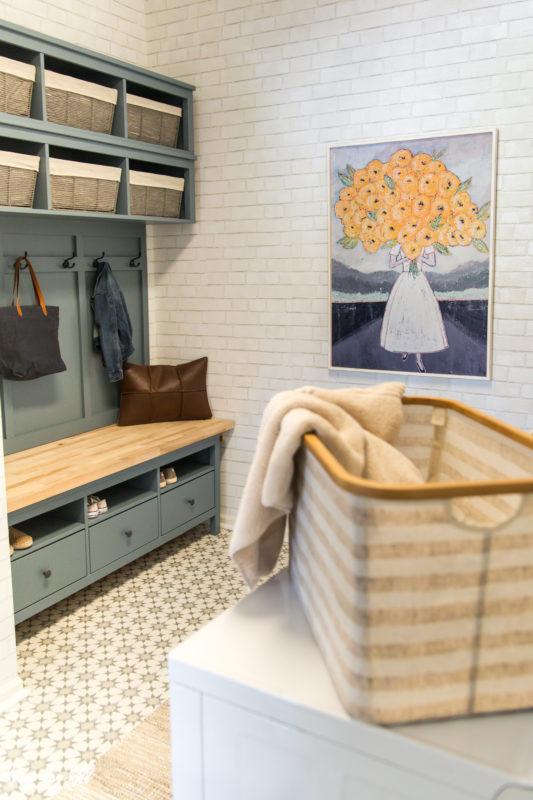 Mudroom with wood framed floral art from Walmart