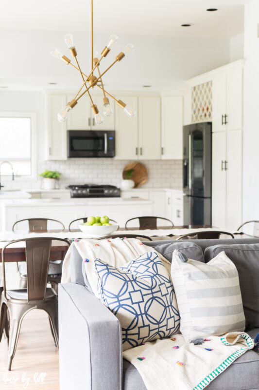 Renovated Open Concept Home with White Kitchen and Modern Chandelier