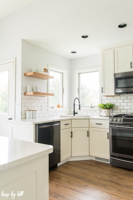Renovated Kitchen with White Subway Tile and Open Shelving