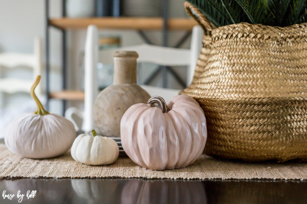 Up close picture of the seagrass basket and pumpkins.