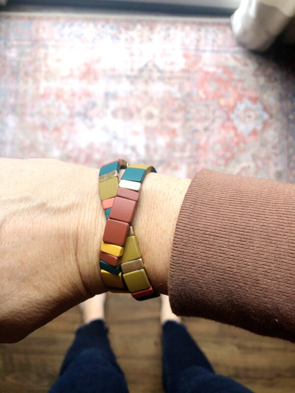 Multi coloured wooded bracelets.