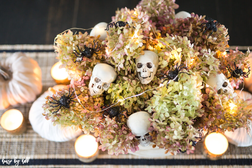 Halloween Centerpiece Idea with Skeletons and Spiders