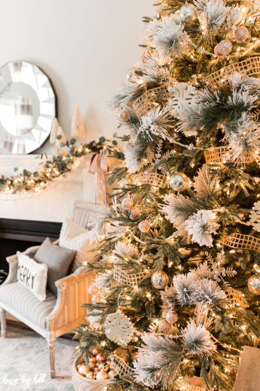 Christmas Tree with Flocked Branches and Rose Gold Ornaments
