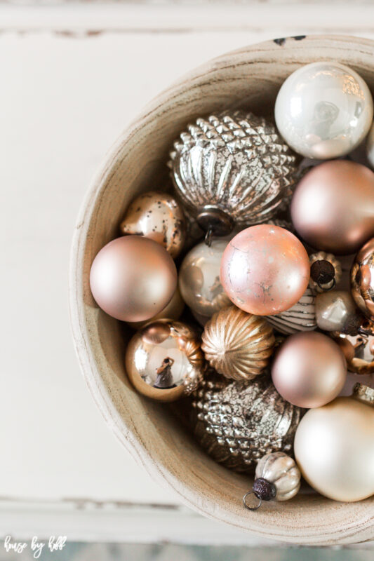 Big Wooden Bowl on Coffee Table with Vintage Rose Gold and Cream Ornaments