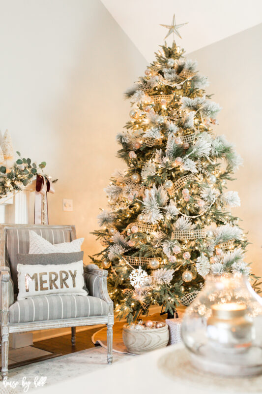 Large Christmas Tree decorated in neutral and pink ornaments