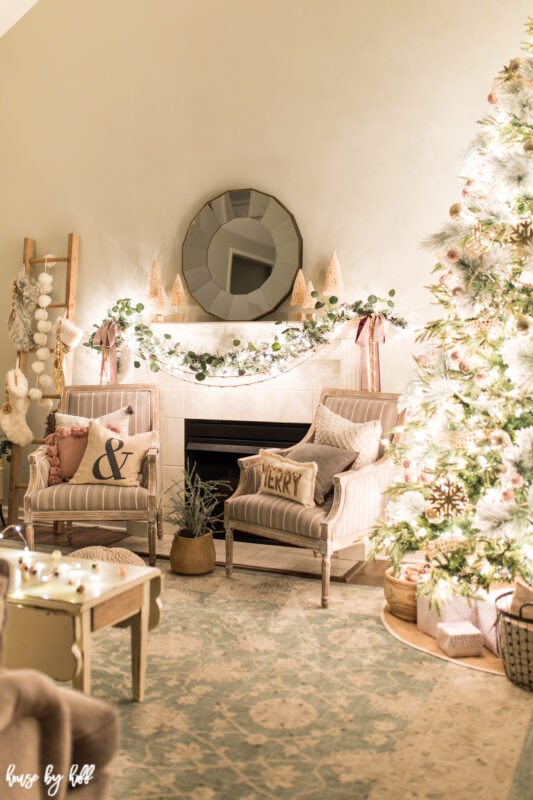 A neutral living room decorated in soft tones for Christmas.
